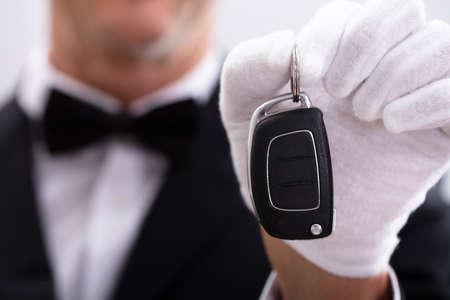 Close-up Of Waiter Wearing Handgloves Holding Car Key