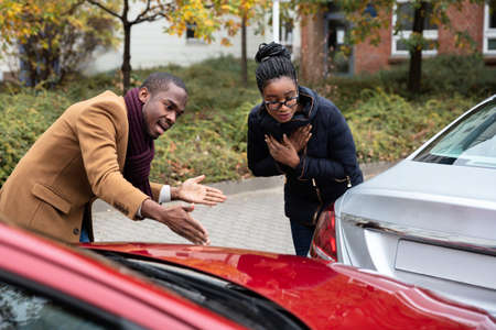 Young African Man And Woman Arguing With Each Other After Car Accident On Street