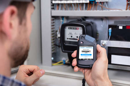 Close-up Of A Male Technician Doing Meter Reading