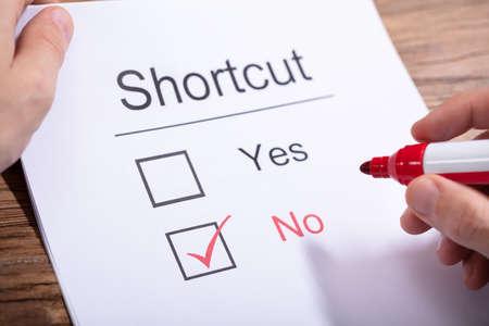 A Person Holding Marker Over Paper With Shortcuts Word Showing Yes And No Option Stock Photo