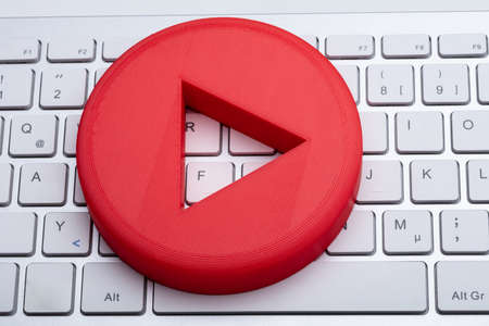 An Elevated View Of Red Play Button On White Keyboard
