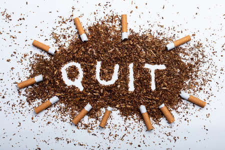 An Elevated View Of Frame Made With Broken Cigarettes Around Quit Word Written On Tobacco