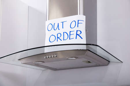Written Text Out Of Order Message On Paper Over The Stuck Extractor Filter In Kitchen