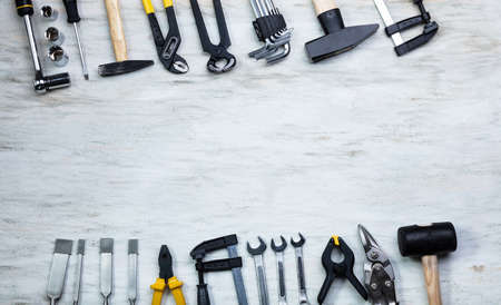 An Overhead View Of Many Yellow Repair Tools Arranged On Wooden Table