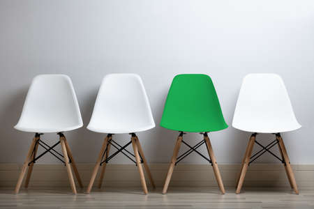 Hiring Concept Of Employees With Empty Chairs In A Row At Office Фото со стока