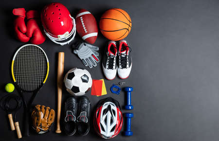 High Angle View Of Various Sport Equipment On Black Background