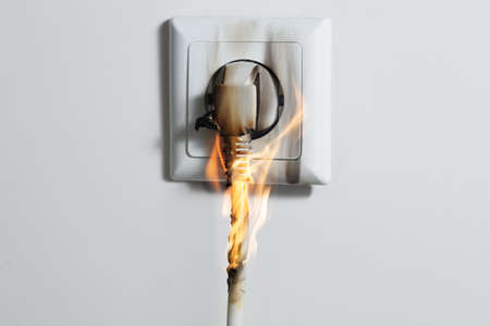 Electric Short Circuit Causing Fire On Plug Socket At Home