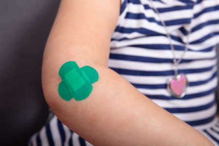 Close-up Of Girl Elbow With An Adhesive Bandage Reklamní fotografie