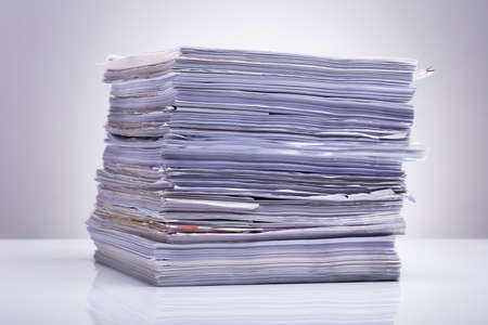 Photo Of Stacked Document Paper On Reflecting Backdrop