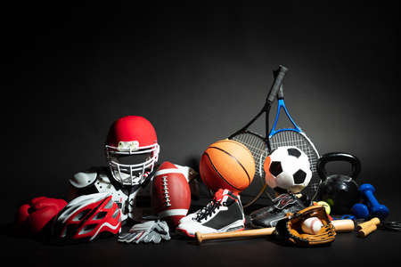 Variety Of Sport Balls And Equipment In Front Of Black Surface
