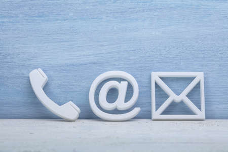 Close-up Of A Phone, Email and Post Icons. Contact us Standard-Bild - 120820555