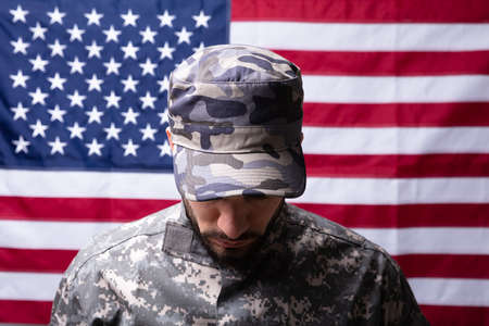 Front View Of Soldier In Front Of Us Flag