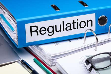 Blue Regulation Folder And Files On Business Desk