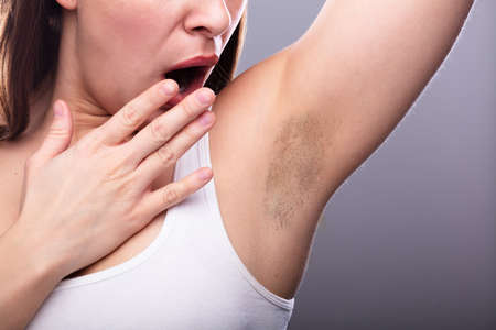 Close-up Of A Young Woman With Hairy Armpit