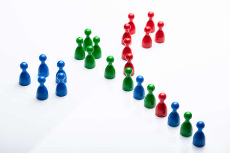 Line Of Colorful Pawn Splitting Into Groups By Color Stock Photo