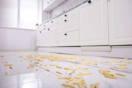 View Of Kitchen With Fallen French Fries On Floor Reklamní fotografie