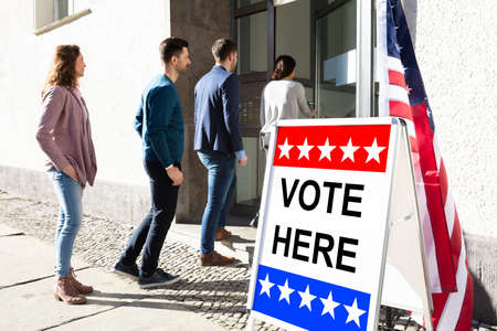 Group Of Young People Standing At The Entrance Of Voting Room Stock Photo