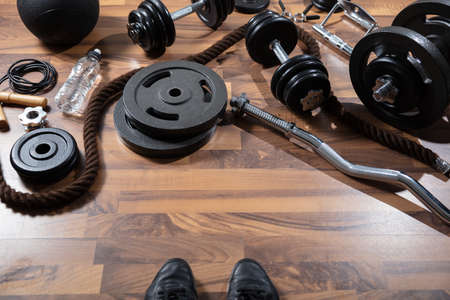 An Elevated View Of Gym Equipment On Hardwood Floor
