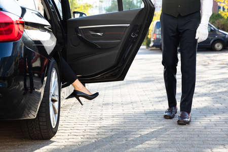 Close-up Of A Woman's Feet With High Heels Getting Out From Car
