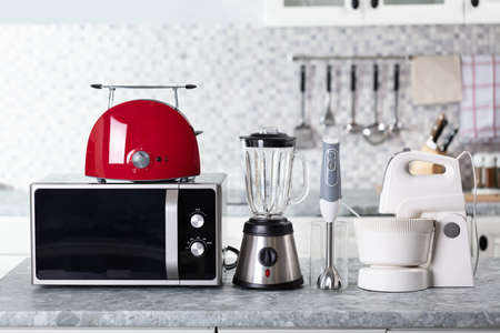 Close-up Of Home Appliance Arranged On Kitchen Worktop Stock Photo