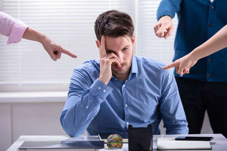 Many Hands Pointing The Stress Businessman At The Workplace Stockfoto