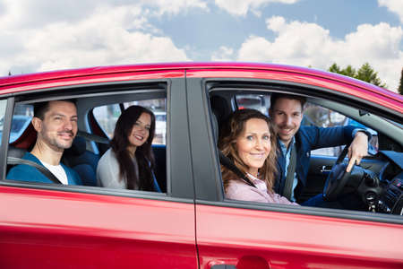 Group Of Happy Friends Having Fun In The Car