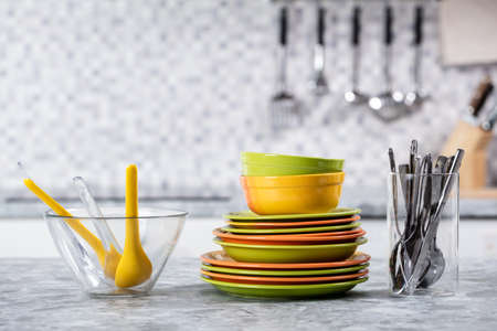 Various Kitchen Utensils Arrange In A Row Over Kitchen Worktop