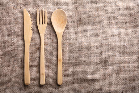 An Overhead View Of Wooden Spoon, Fork And Knife