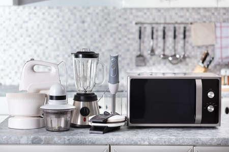 Set Of Home Appliance On Kitchen Worktop Standard-Bild