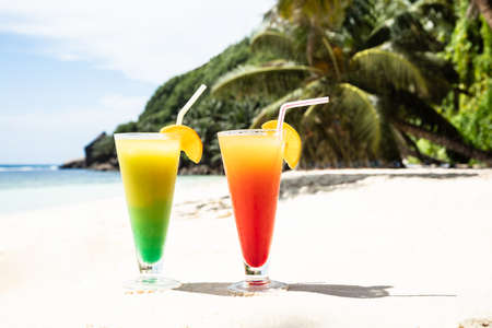 Glasses Of Fresh Cocktail On The Sand On The Beach
