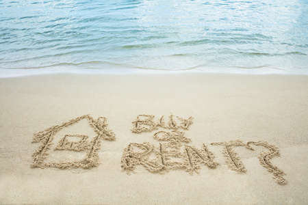 Buy Or Rent Text With Drawn House On Sand Near The Sea At Beach