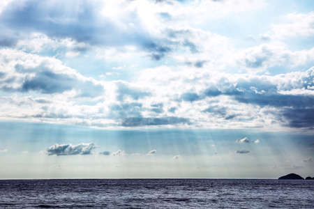 Scenic View Of Sunlight Streaming In The Sky Over The Seascape Stockfoto