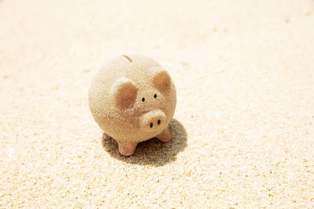 Close-up Of Piggybank Made Out Of Sand On Beach