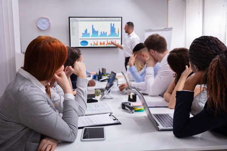 Group Of Business Executives Tired Of Long Meeting In Office Reklamní fotografie