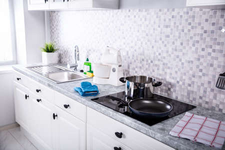 View Of A Modern Kitchen Worktop With Utensils And Induction Stove