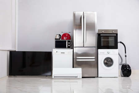 Set Of Modern Appliances On Reflective White Floor In The New Kitchen Apartment Imagens
