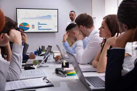 Group Of Business Executives Tired Of Long Meeting In Office Stockfoto