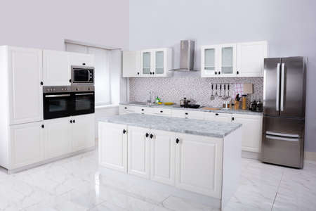 Interior Of Modern White Clean Kitchen With Microwave Oven And Refrigerator Stockfoto - 124789726