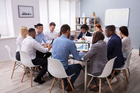Group Of Multi Ethnic Business Team Sitting Together At Workplace In Modern Office Stockfoto