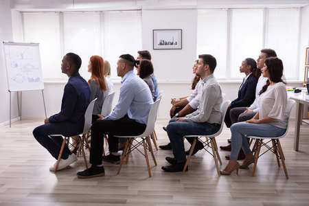 Diverse Group Of Successful Business People Sitting On Chair In The Conference Room Stockfoto