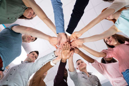 Multi-ethnic Group Of People Stacking Hand Showing Unity
