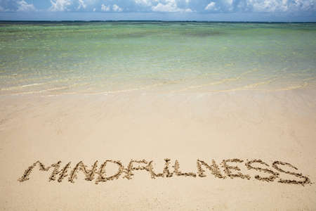 An Overhead View Of Mindfulness Written Text On Sand Near The Sea At Beach Stok Fotoğraf