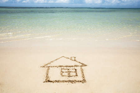 Close-up Of Hand Drawn House Near The Idyllic Sea On The Beach