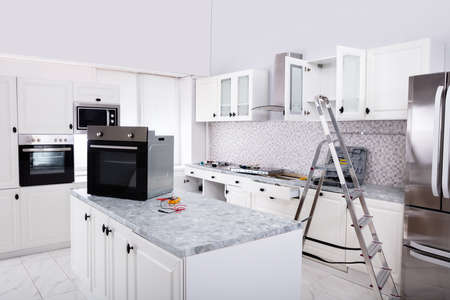 Installing New Micro Oven And Induction Hob In Modern Kitchen Banque d'images