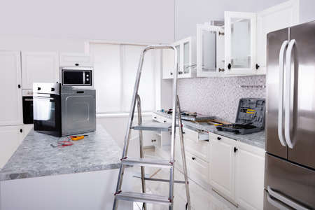 Installing New Micro Oven And Induction Hob In Modern Kitchen Zdjęcie Seryjne