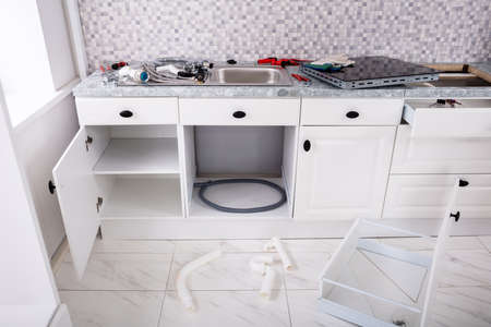 Installation Of An Electrical Kitchen Induction Ceramic Hob And Sink In Kitchen With Tools Furniture