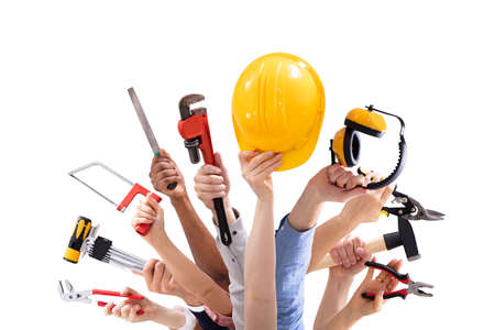 Close-up Of Peoples Hand Holding Carpentry Tools Against White Background