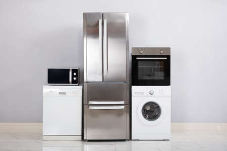 Close-up Of Home Electronic Appliances On Floor Against Grey Wall In New House