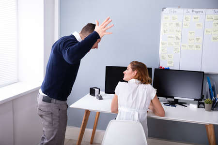 Angry Businessman Shouting At Female Executive In Office Stock fotó