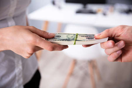 Close-up Of Human's Hand Exchanging The Money